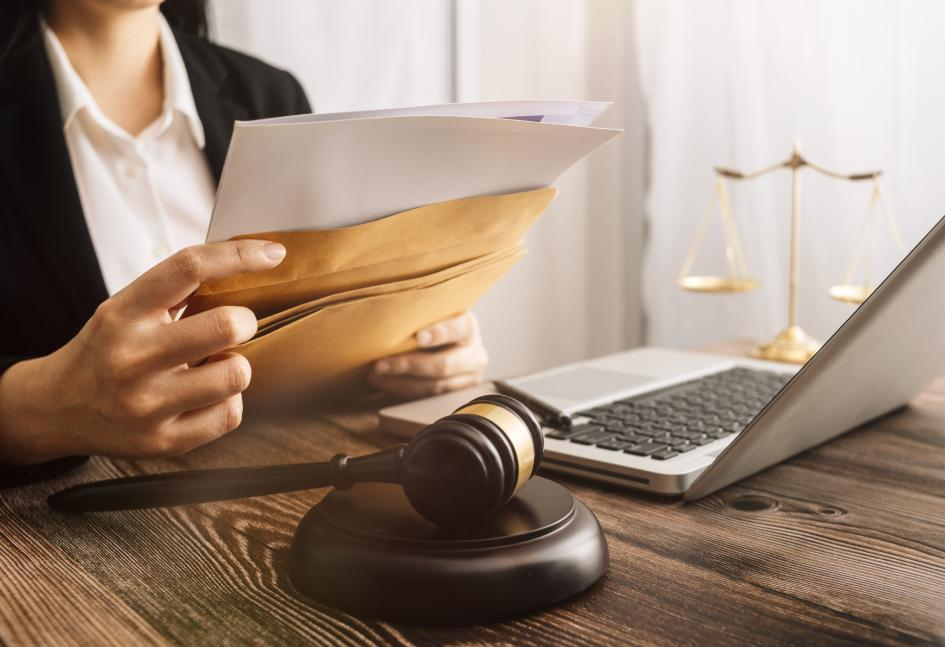 Attorney holding client files